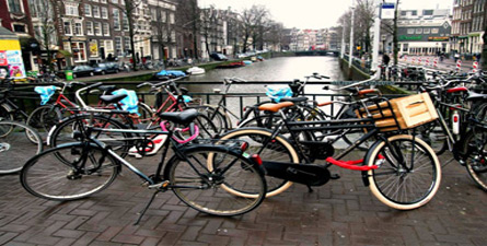 Hop on a bicycle and venture across the canals and narrow cobblestone streets of Amsterdam!